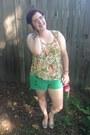Green-rip-curl-shorts-beige-material-top-gold-baublebar-earrings