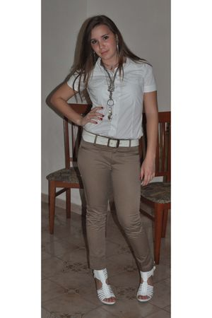 white shirt - white waistband accessories - beige pants - beige necklace accesso