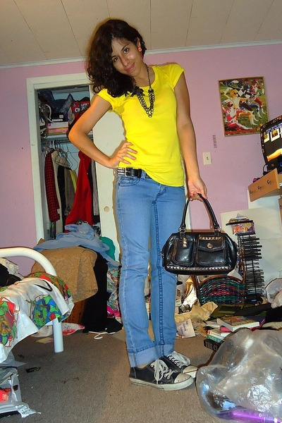 yellow shirt and blue jeans