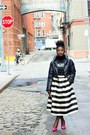 Black-graphic-tee-von-dutch-shirt-white-striped-tibi-skirt