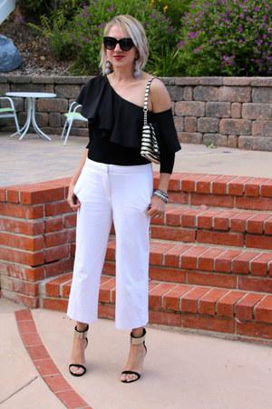 black Gucci sunglasses - white striped kate spade purse