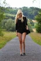 black shorts - black loafers - pink swimwear