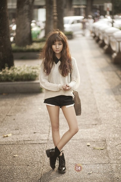 black boots - tan bag - black shorts - ivory sweatshirt