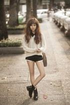 black boots - tan bag - black shorts - ivory sweatshirt