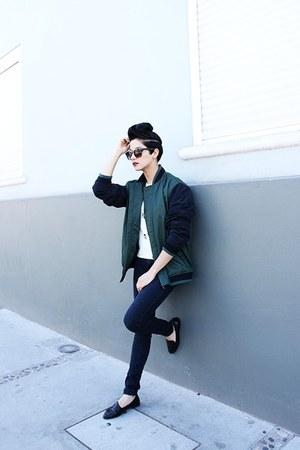 forest green varsity jacket Oscar de la Renta jacket - navy jeggings Levis jeans