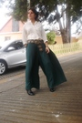 Black-boots-green-pants-beige-blouse-brown-belt