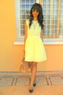 Light-yellow-baby-doll-dress-black-christian-louboutin-pumps