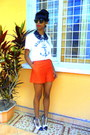 Carrot-orange-lace-shorts-white-t-shirt-white-christian-louboutin-pumps