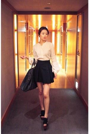 black bag - white blouse
