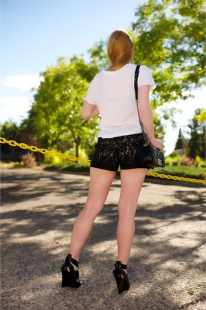 black boy Chanel bag - white tee R13 shirt - black leather Alice  Olivia shorts