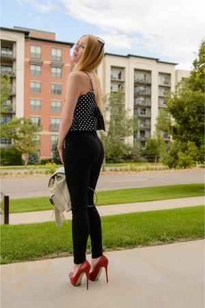 black polka dot Artistic Revolution in Time top - black skinny Level 99 jeans