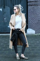 camel coat - black bag