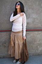 dark brown sunglasses - camel skirt