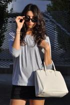 black Pierre Balmain skirt - white Prada bag - black Celine sunglasses