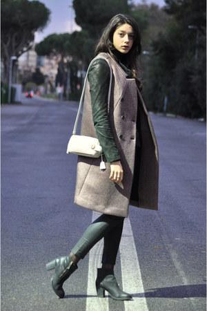 black sweep Kurt Geiger boots - light pink clutch Prada bag