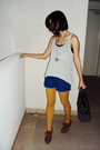 Yellow-topshop-tights-brown-shoes-blue-cotton-on-shorts-white-forever21-to