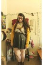 Brown-boots-black-skirt-white-blouse-gold-cardigan