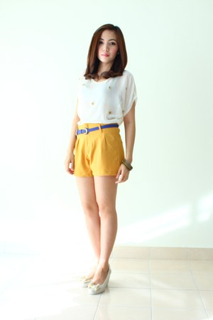 mustard shorts - ivory sheer top - navy leather belt - off white wedges
