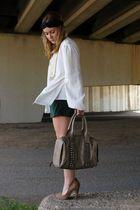 studded purse on a windy day