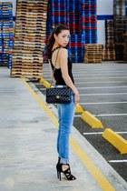 blue Levis jeans - black Tweeds top