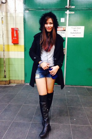 black coat - black boots - navy shorts