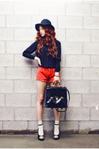 black hat - black bag - red shorts - white socks - black blouse