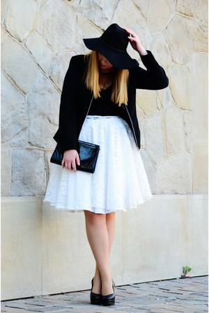 black hat - white skirt