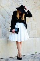 black hat - white skirt