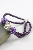 purple CrossWoodStore bracelet