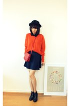 carrot orange loose CrossWoodStore sweater - black ankle boots Kurt Geiger boots