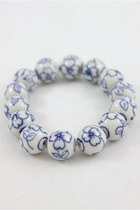 white CrossWoodStore bracelet