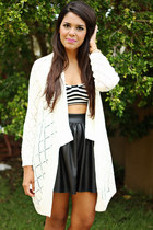 ivory knitted cardigan - black faux leather skirt