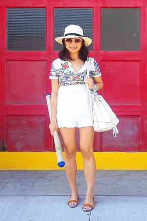white shorts - blue top - tawny sandals