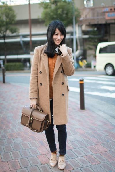 tan coat - black jeans - brown bag