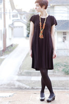 orange vintage necklace - black dress - black cut out calvin klein wedges