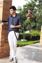 navy shirt - black accessories - navy sneakers - white pants