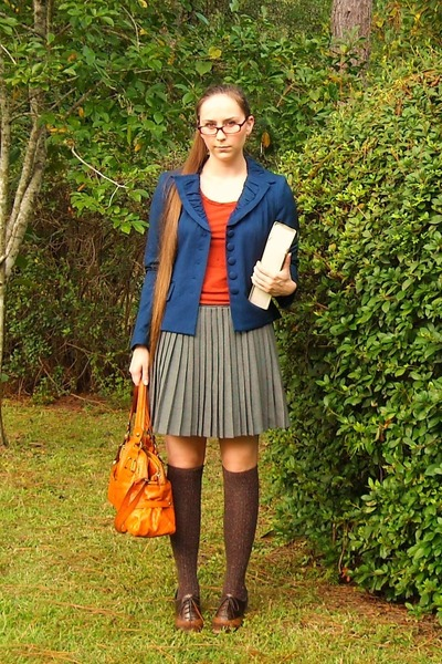 blue jacket - brown shoes - orange shirt - brown socks - gray skirt - orange