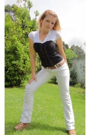 black shirt - white pants - camel sandals