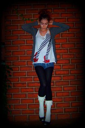 white top - black tights - blue shorts - white socks - gray cardigan