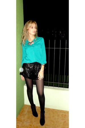 black boots - black shorts - turquoise blue blouse