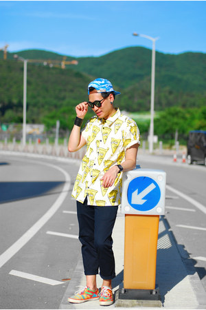 sky blue Agora hat - light yellow short sleeve Lazy Oaf shirt