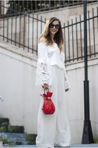white Inia Lavin pants - red sammydress bag - black Prada sunglasses