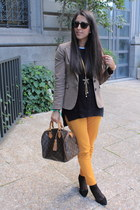 gold jeans - black sweater - dark brown bag