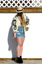 white Uforia and Muse sweater