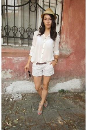 ivory chiffon shirt - mustard New Yorker hat - pants - tan open toe sandals