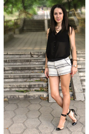 black classic Chanel bag - black and white Stradivarius shorts