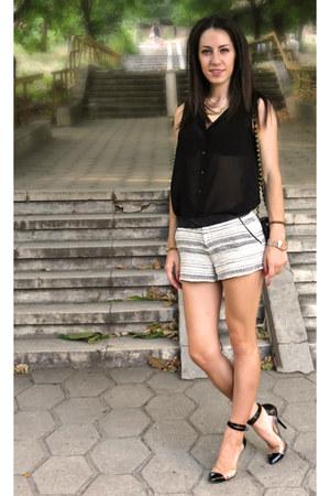 black classic Chanel bag - black and white Stradivarius shorts
