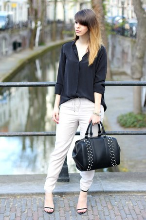 black studded Zara bag - off white H&amp;M Trend pants - black silk COS top