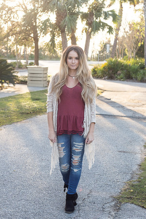 black tassle booties boots - navy jeans - black necklace - beige fringe cardigan