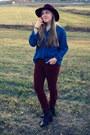 Dark-brown-kohls-boots-maroon-target-hat-tawny-kohls-pants